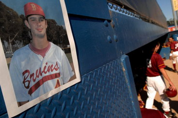 A photo of former Wilson High School player Gary DeVercelly hangs above the Wilson dugout at Blair Field in memory of DeVercelly, 18, who died Friday March 30th after excessive drinking at a fraternity house in Trenton, New Jersey. The Mercer County Prosecutor's office is investigating his death as a possible hazing incident.